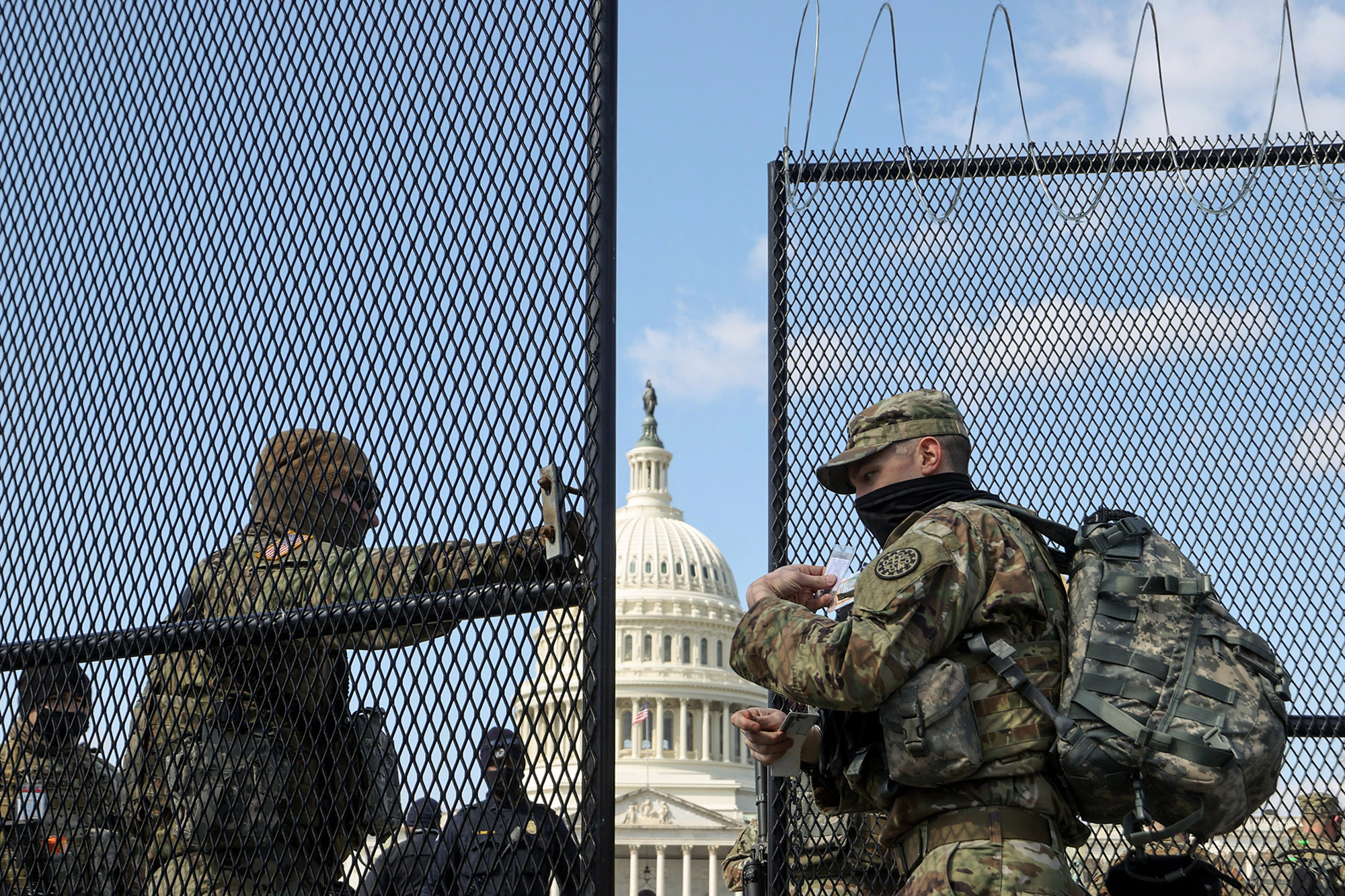 National Guard soldiers patrol the grounds of the U.S. Capitol after police warned that a militia group might try to attack the Capitol complex in Washington, DC.