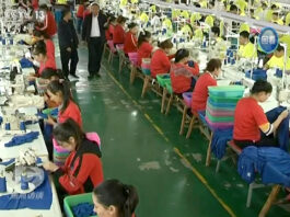 Muslim trainees work in a garment factory at the Hotan Vocational Education and Training Center in Hotan, Xinjiang, northwest China.