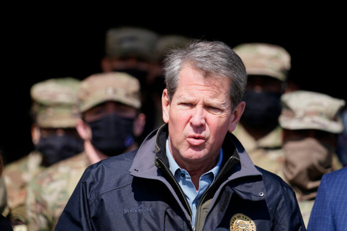 Georgia Gov. Brian Kemp speaks to reporters after touring a mass vaccination site at the Macon State Farmers Market on Friday, Feb. 19, 2021, in Atlanta.