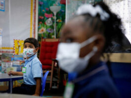 A student wearing a protective mask, attends class on the first day of school, amid the coronavirus pandemic in Florida, U.S. August 18, 2021.