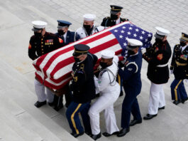 Justice Ruth Bader Ginsburg's casket is brought to the US Capitol building to lie in state after her death on September 18, 2020.
